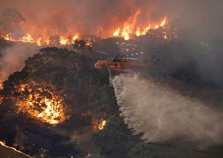 On Monday, Dec. 30, 2019, this photo provided by the State Government of Victoria, shows a helicopter tackles a wildfire in East Gippsland, Victoria state, Australia. (State Government of Victoria via AP)
