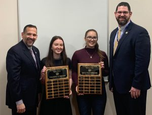 Principal, Frank Pugliese, Valedictorian, Jackie Holden, Salutatorian, Stephanie Searing, and Assistant Principal John Holownia pose for a photograph with the updated Valedictorian and Salutatorian plaques.
