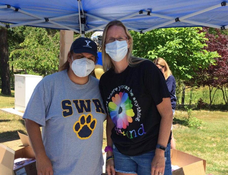 Ms. Eschbach and Mrs. Mitchell wear their masks at the June 12 Senior Sendoff. You can't see it, but they are definitely smiling.