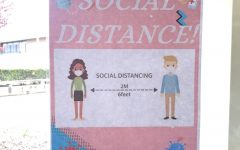 A poster in the SWR HS lobby reminding people to maintain social distance.